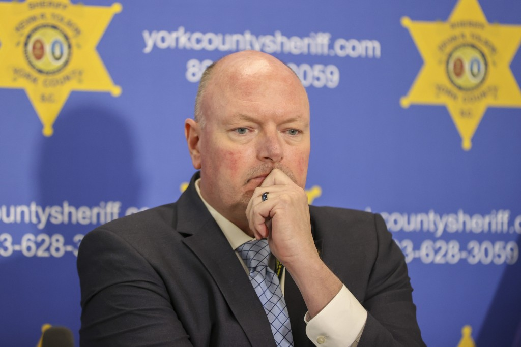York County Sheriff Kevin Tolson listens as a 911 call is played during a press conference on Thursday, April 8, 2021, in York, S.C. where he addresse...