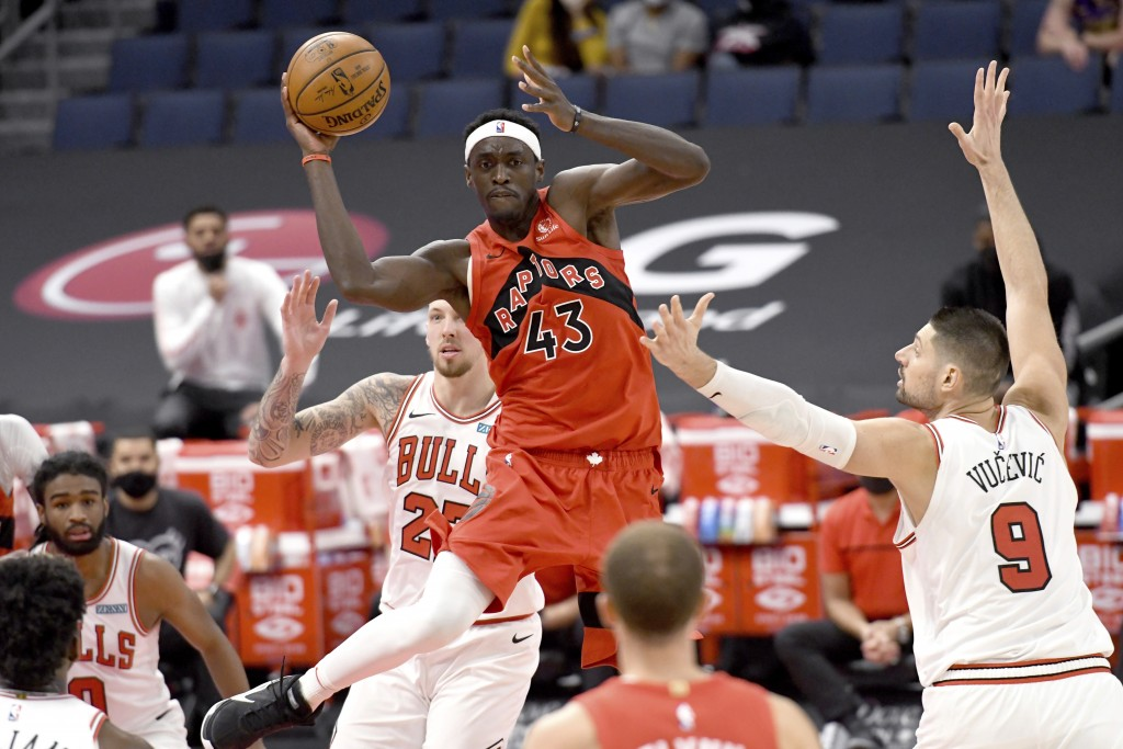 Toronto Raptors forward Pascal Siakam (43) looks to pass the ball against the Chicago Bulls during the second half of an NBA basketball game Thursday,...