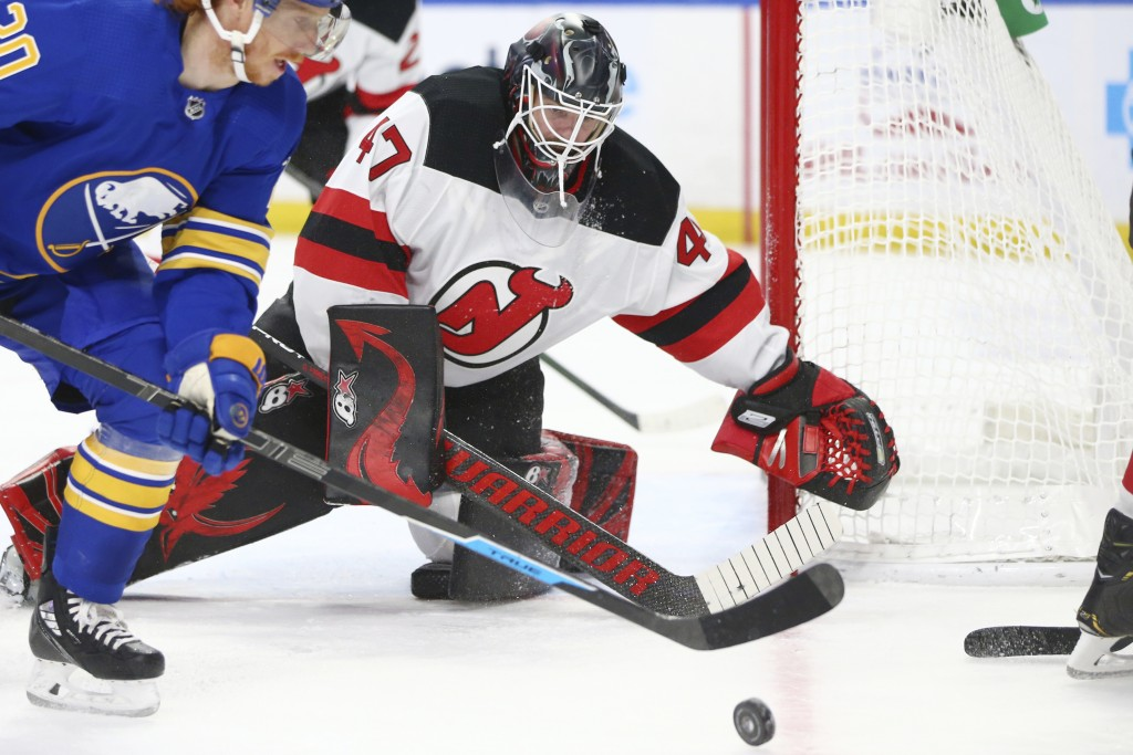 New Jersey Devils goalie Aaron Dell (47) watches the puck during the second period of the team's NHL hockey game against the Buffalo Sabres, Thursday,...