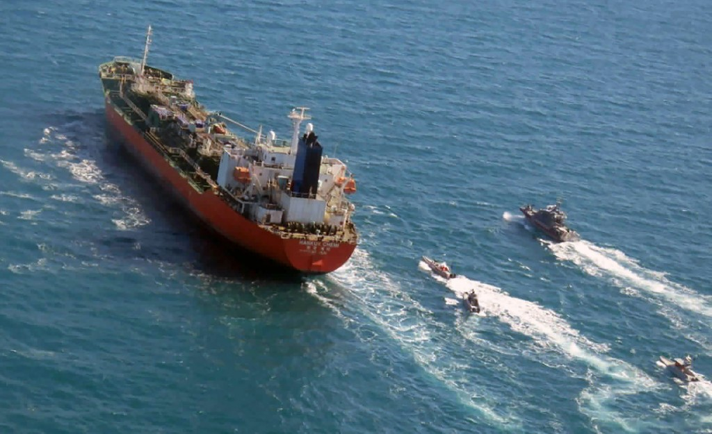 FILE - In this Jan. 4, 2021, file photo released by Tasnim News Agency, a seized South Korean-flagged tanker is escorted by Iranian Revolutionary Guar...