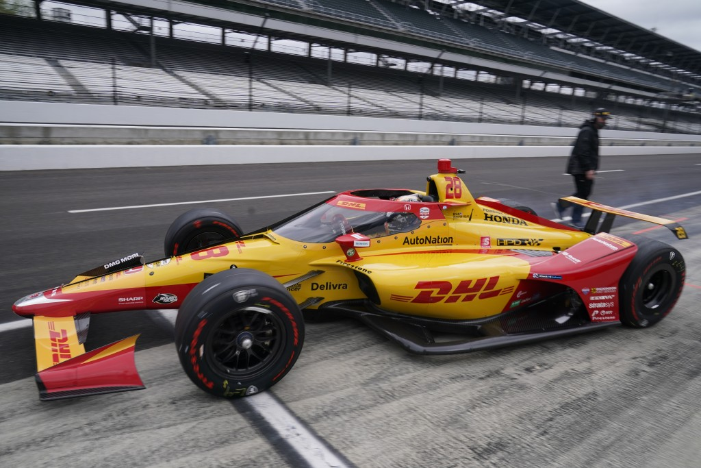 Ryan Hunter-Reay pulls out of the pits during testing at the Indianapolis Motor Speedway, Thursday, April 8, 2021, in Indianapolis. (AP Photo/Darron C...
