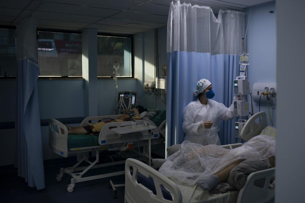 COVID-19 patients are treated in the municipal hospital of Sao Joao de Meriti, Rio de Janeiro state, Brazil, Thursday, April 8, 2021. (AP Photo/Felipe...