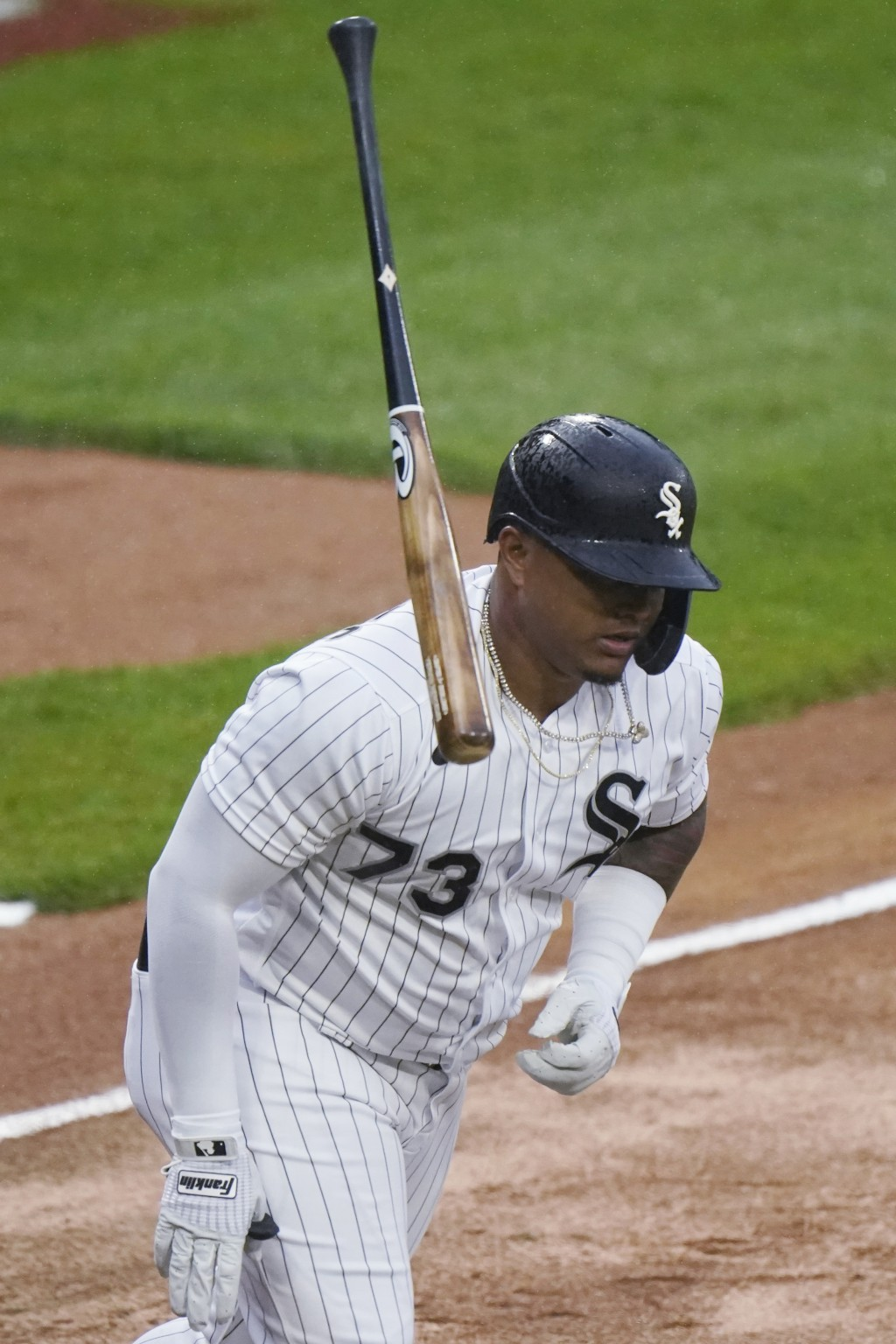 Chicago White Sox's Yermin Mercedes flips his bat after hitting a solo home run against the Kansas City Royals during the first inning of a baseball g...