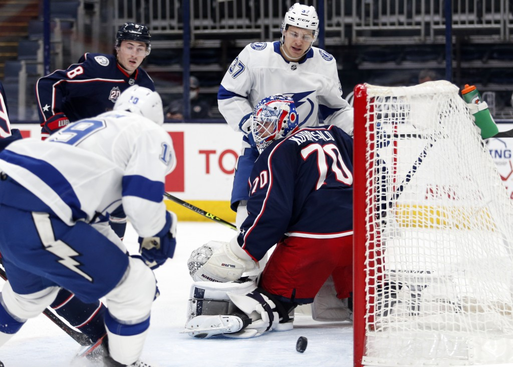 Tampa Bay Lightning forward Barclay Goodrow (19) scores past Columbus Blue Jackets goalie Joonas Korpisalo (70) in front of Blue Jackets defenseman Za...