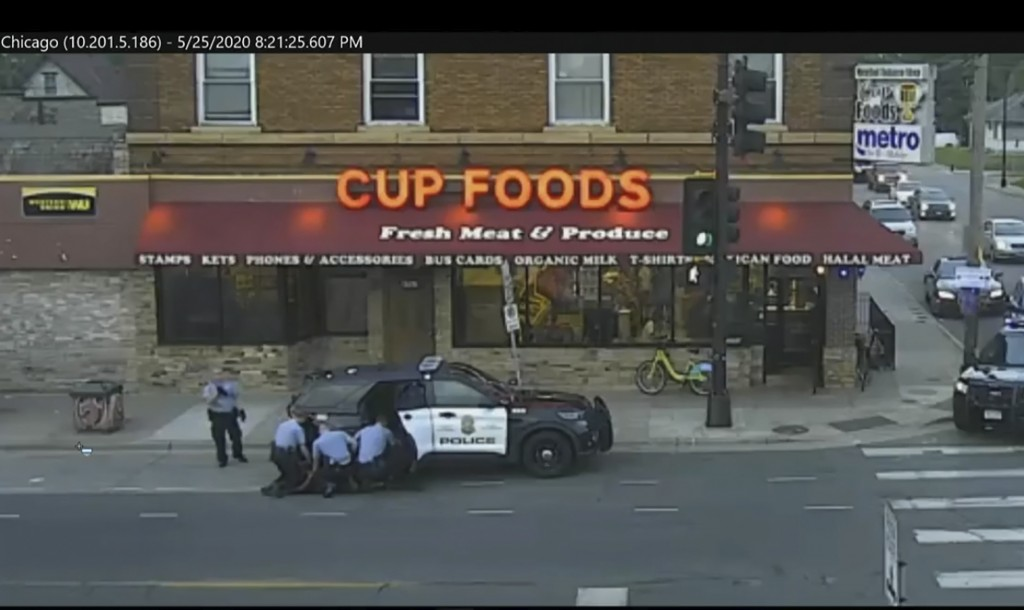 FILE - In this May 25, 2020 file image from Minneapolis city surveillance video, Minneapolis police are seen attempting to take George Floyd into cust...