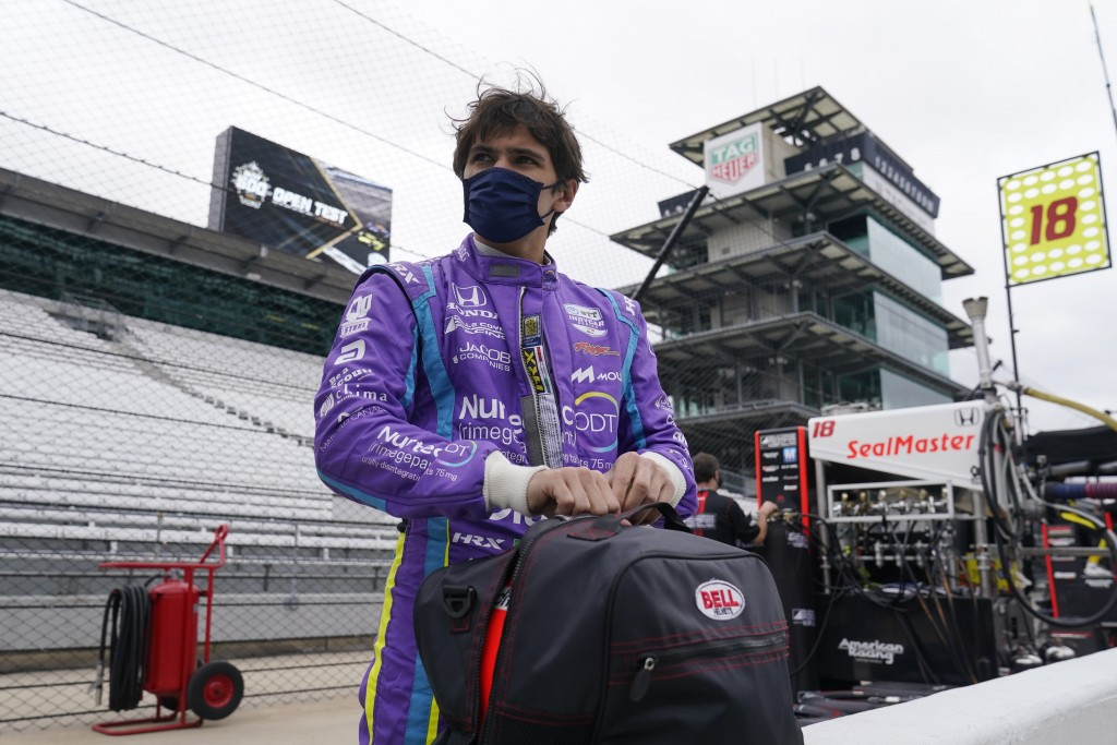 Pietro Fittipaldi, of Brazil, waits in the pits during testing at the Indianapolis Motor Speedway, Thursday, April 8, 2021, in Indianapolis. (AP Photo...