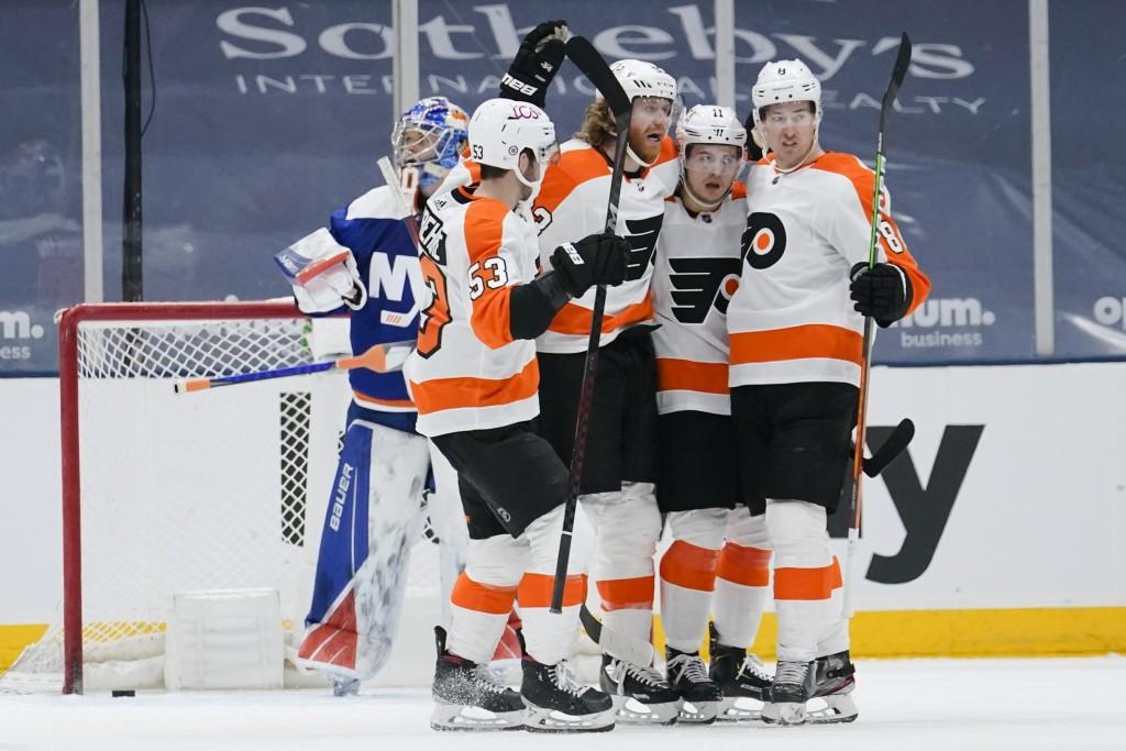 Philadelphia Flyers' Jakub Voracek, center, celebrates with teammates Travis Konecny (11), Robert Hagg (8) and Shayne Gostisbehere (53) after scoring ...