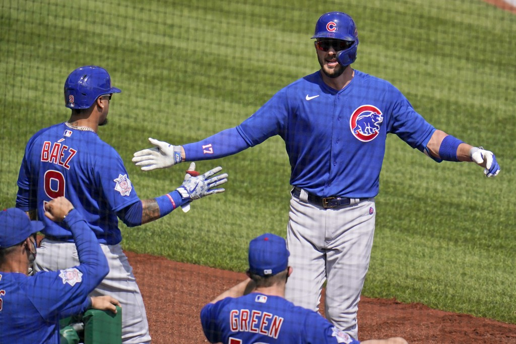 Chicago Cubs' Kris Bryant, right, returns to the dugout after hitting a solo home run off Pittsburgh Pirates starting pitcher Tyler Anderson during th...