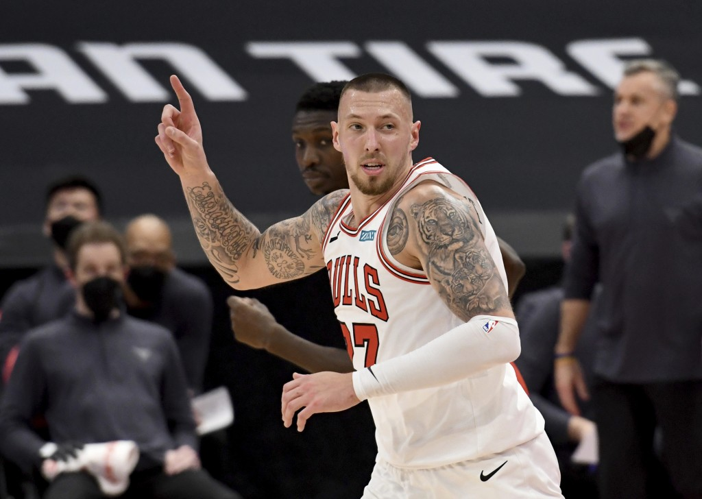Chicago Bulls center Daniel Theis celebrates a dunk against the Toronto Raptors during the second half of an NBA basketball game Thursday, April 8, 20...