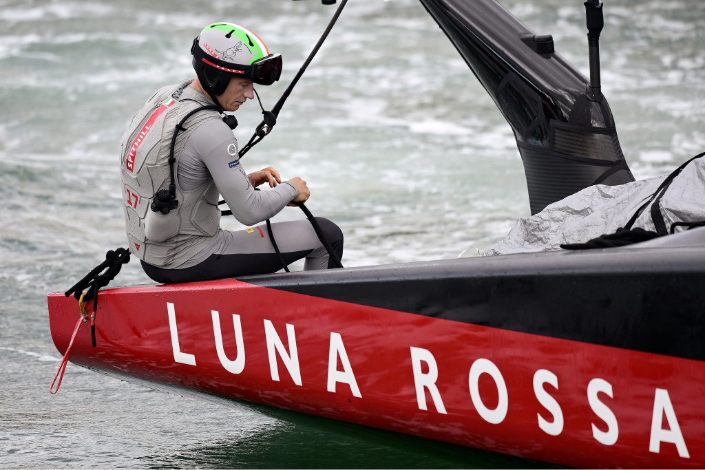 FILE - In this March 14, 2021, file photo, helmsman Jimmy Spithill sits on the gunwale as Italy's Luna Rossa is towed back to dock after race 7 agains...