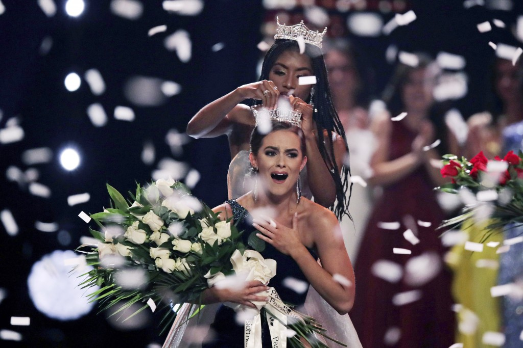 FILE - In this Dec. 19, 2019, file photo, Camille Schrier, of Virginia, reacts as she is crowned by 2019 Miss America Nia Franklin after winning the M...