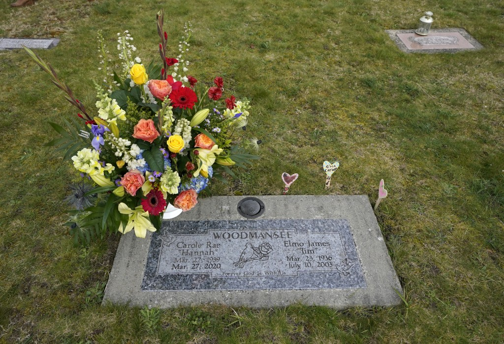Flowers from her memorial service mark the headstone shared by Carole Rae Woodmansee and her husband Jim (who died in 2003), Saturday, March 27, 2021,...
