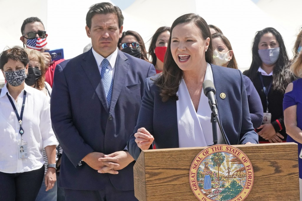 Florida Attorney General Ashley Moody speaks alongside Gov. Ron DeSantis during a news conference, Thursday, April 8, 2021, at PortMiami in Miami. DeS...