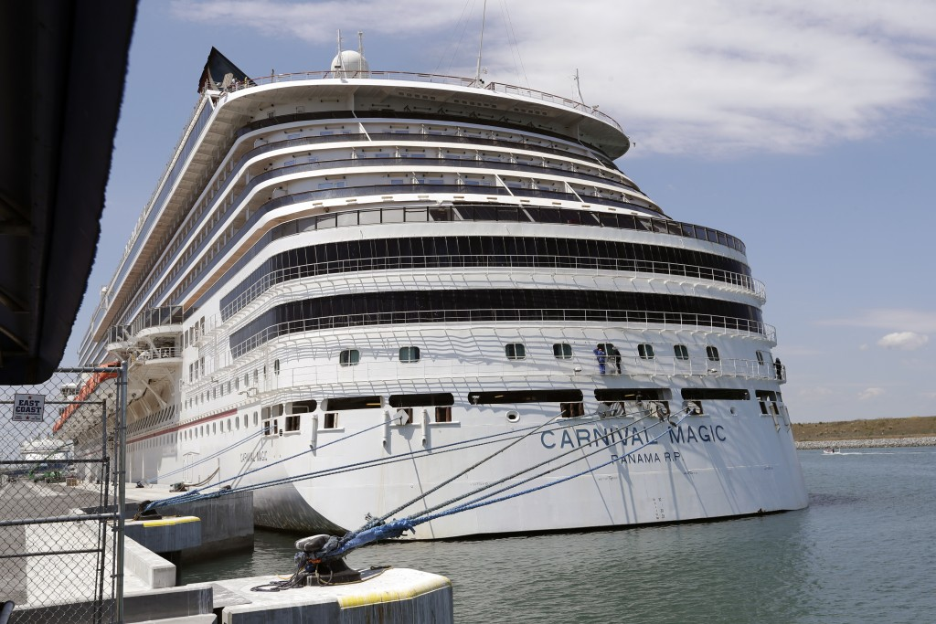 FILE -In this Saturday, April 4, 2020, file photo, Carnival cruise line ship Carnival Magic is docked at Port Canaveral, in Cape Canaveral, Fla. Carni...