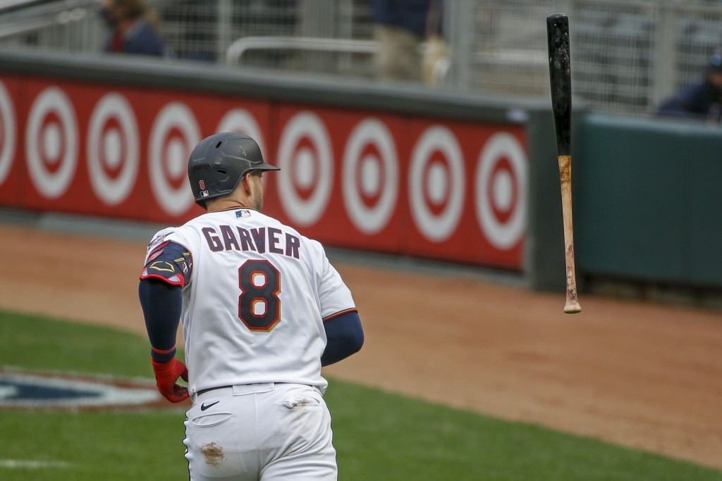 Minnesota Twins' Mitch Garver flips his bat after hitting a three run home run against the Seattle Mariners in the third inning of a baseball game Thu...