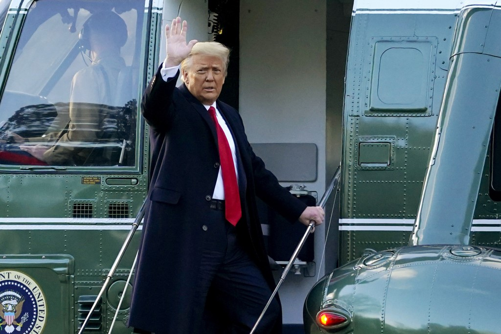 FILE - In this Wednesday, Jan. 20, 2021, file photo, President Donald Trump waves as he boards Marine One on the South Lawn of the White House, in Was...