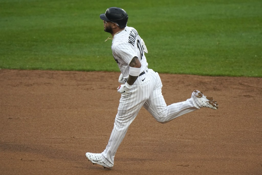 Chicago White Sox's Yoan Moncada runs the bases after hitting a two-run home run during the first inning of the team's baseball game against the Kansa...