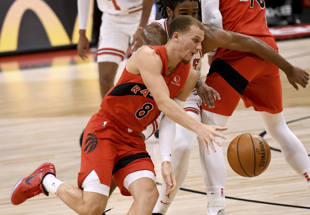 Toronto Raptors guard Malachi Flynn (8) drives toward the basket against the Chicago Bulls during the first half of an NBA basketball game Thursday, A...