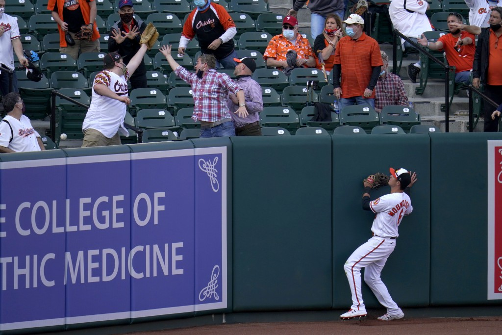 Baltimore Orioles left fielder Ryan Mountcastle looks on as a ball goes over the wall on a solo home run by Boston Red Sox's Enrique Hernandez during ...