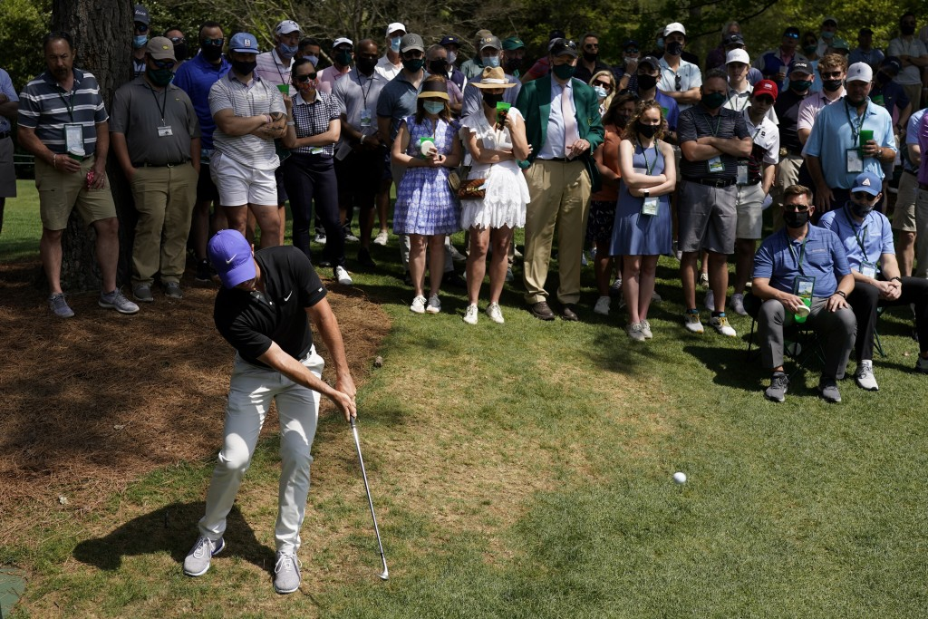 Rory McIlroy, of Northern Ireland hits out of the rough on the sixth hole during the first round of the Masters golf tournament on Thursday, April 8, ...