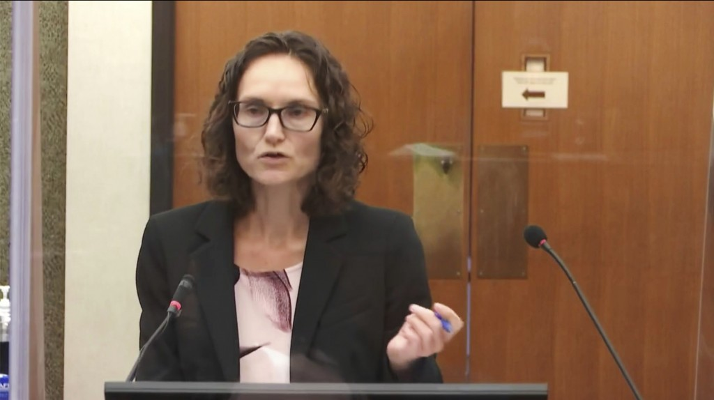 In this image taken from video, prosecutor Erin Eldridge questions witness Daniel Isenschmid, a forensic toxicologist as Hennepin County Judge PeterC...