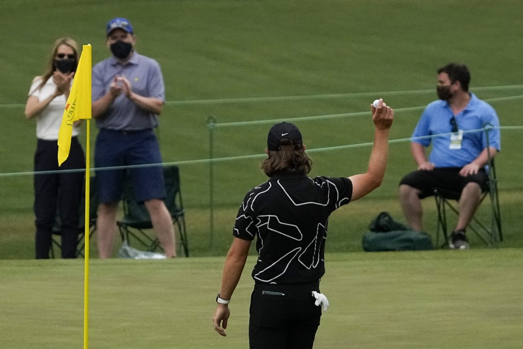 Tommy Fleetwood, of England, holds up his ball after a hole-in-one on the16th hole during the first round of the Masters golf tournament on Thursday, ...