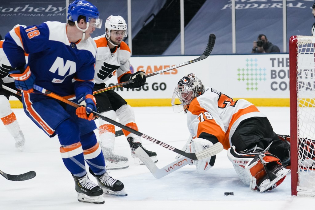 Philadelphia Flyers goaltender Carter Hart (79) stops a shot on goal by New York Islanders' Anthony Beauvillier (18) during the second period of an NH...