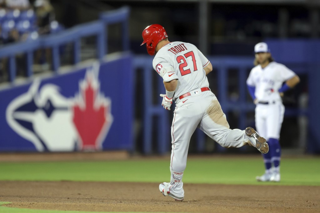 Los Angeles Angels' Mike Trout rounds the bases in front of Toronto Blue Jays shortstop Bo Bichette after his solo home run during the fifth inning of...