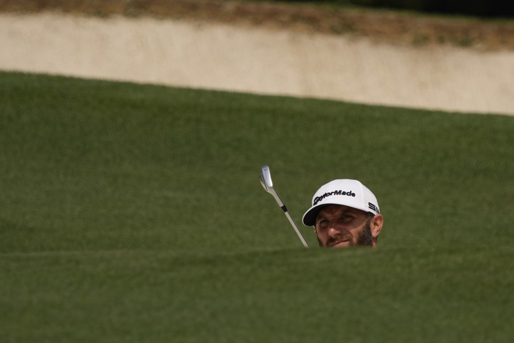 Dustin Johnson prepares to hit on the fifth hole during the first round of the Masters golf tournament on Thursday, April 8, 2021, in Augusta, Ga. (AP...