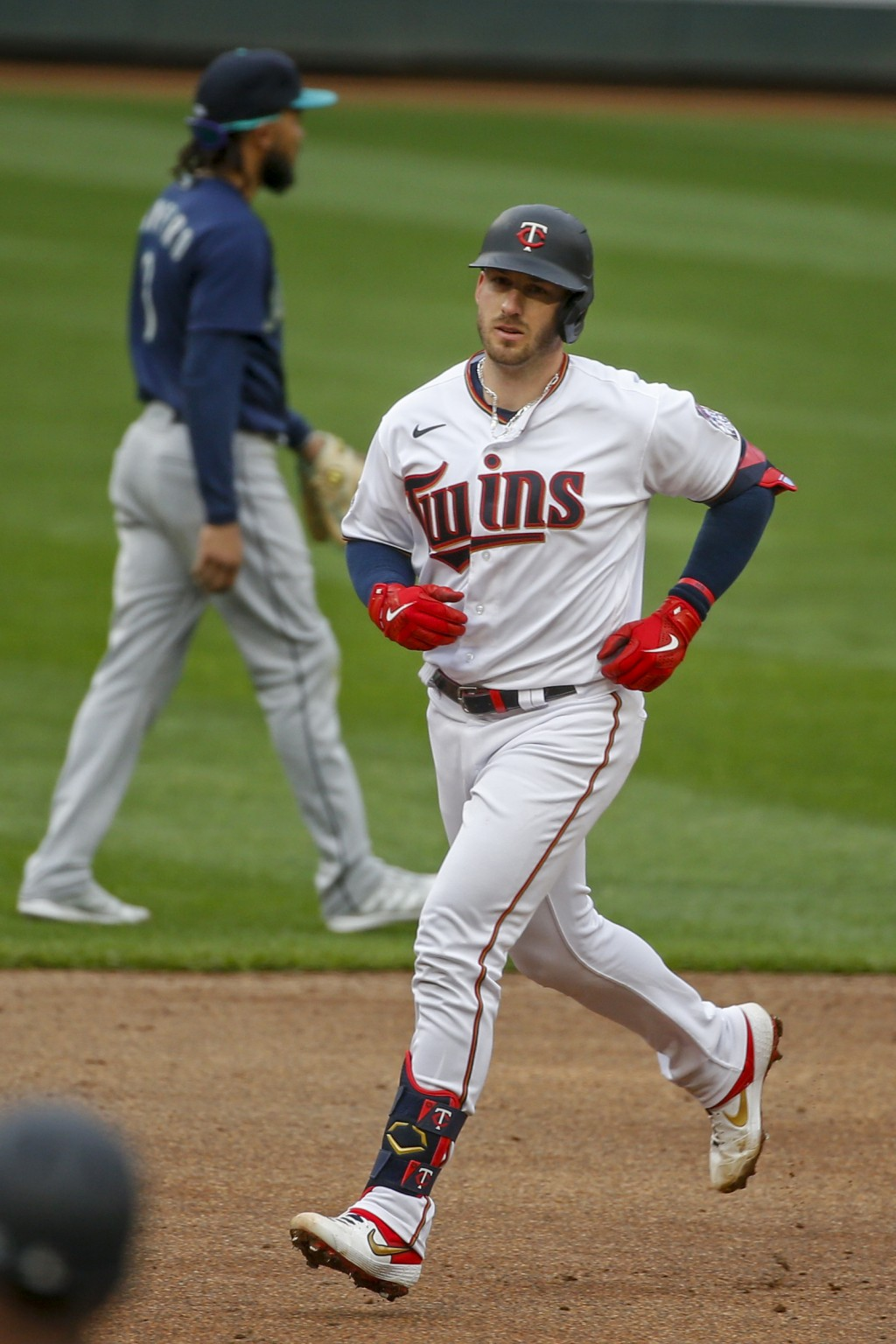Minnesota Twins' Mitch Garver runs the bases after hitting a three run home run against the Seattle Mariners in the third inning of a baseball game Th...