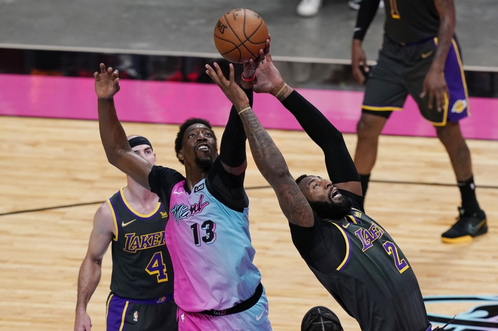 Miami Heat center Bam Adebayo (13) and Los Angeles Lakers center Andre Drummond (2) go after a rebound during the second half of an NBA basketball gam...