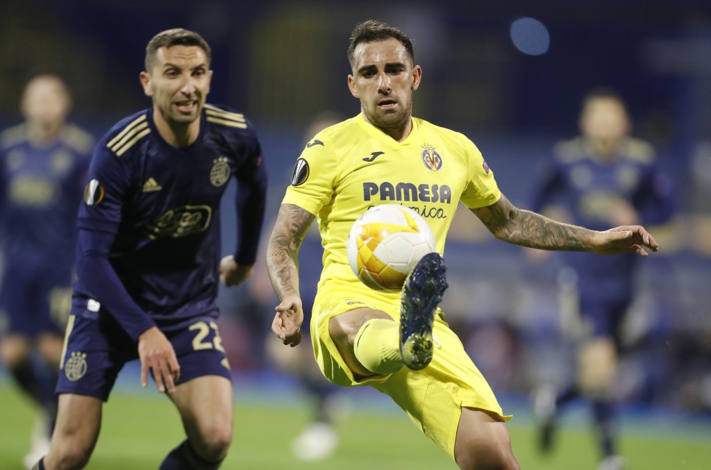 Dinamo Zagreb's Marin Leovac, left, and Villareal's Paco Alcacer challenge for the ball during the Europa League, first leg, quarterfinal soccer match...