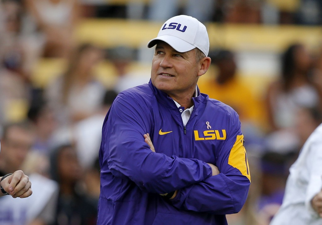 FILE - Then-LSU head coach Les Miles watches his team warm up before an NCAA college football game against Florida in Baton Rouge, La., in this Saturd...