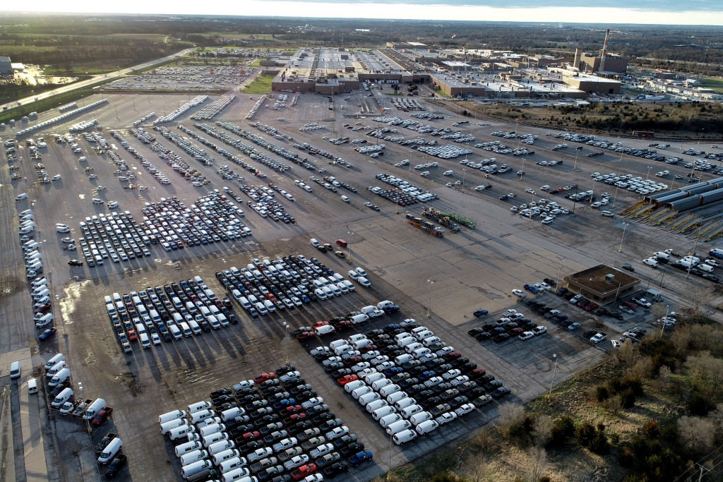 In this aerial photo, a General Motors assembly plant is seen at top right while mid-sized pickup trucks and full-size vans currently produced at the ...