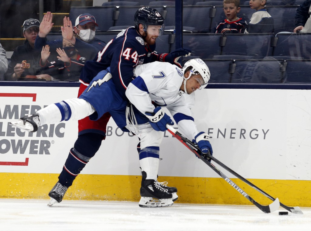 Columbus Blue Jackets defenseman Vladislav Gavrikov, left, grabs Tampa Bay Lightning forward Mathieu Joseph during the second period of an NHL hockey ...