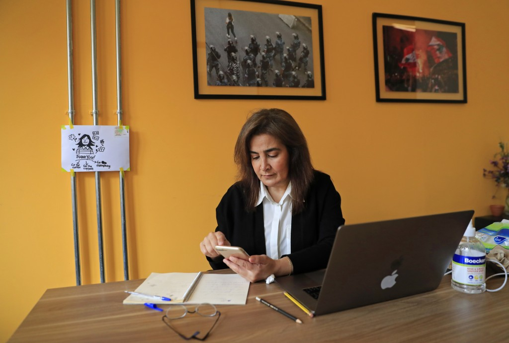 Diana Moukalled, a Lebanese journalist who closely follows social media checks the Clubhouse application, at her office in Beirut, Lebanon, Wednesday,...