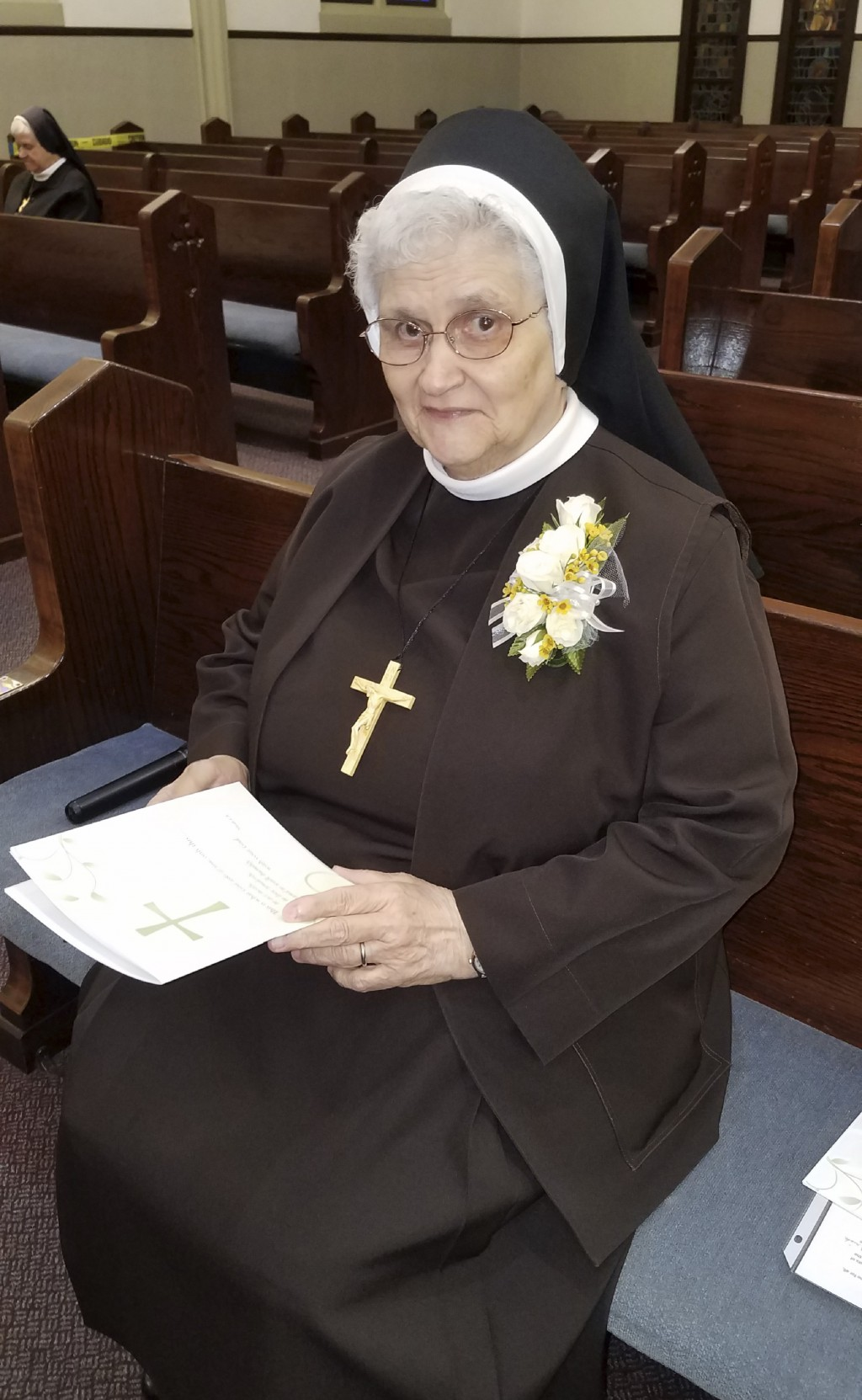 In this photo provided by Sister Mary Jeanine Morozowich, Sister Mary Evelyn Labik is recognized for her 60 years with the Felician Sisters of North A...