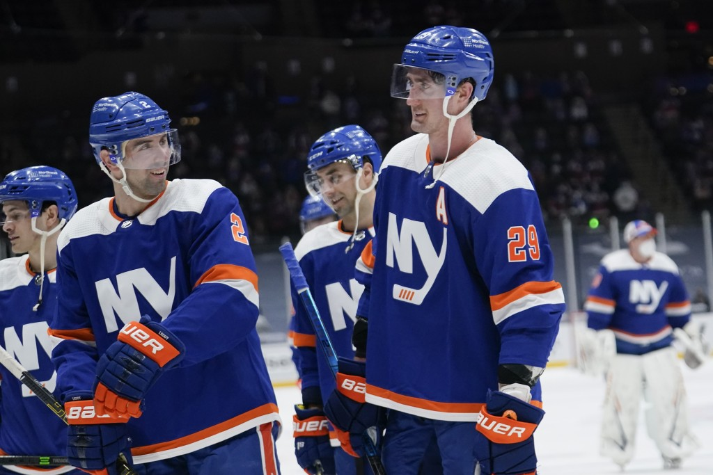 New York Islanders' Nick Leddy (2) celebrates with Brock Nelson (29) as they leave the ice after an NHL hockey game against the Philadelphia Flyers Th...