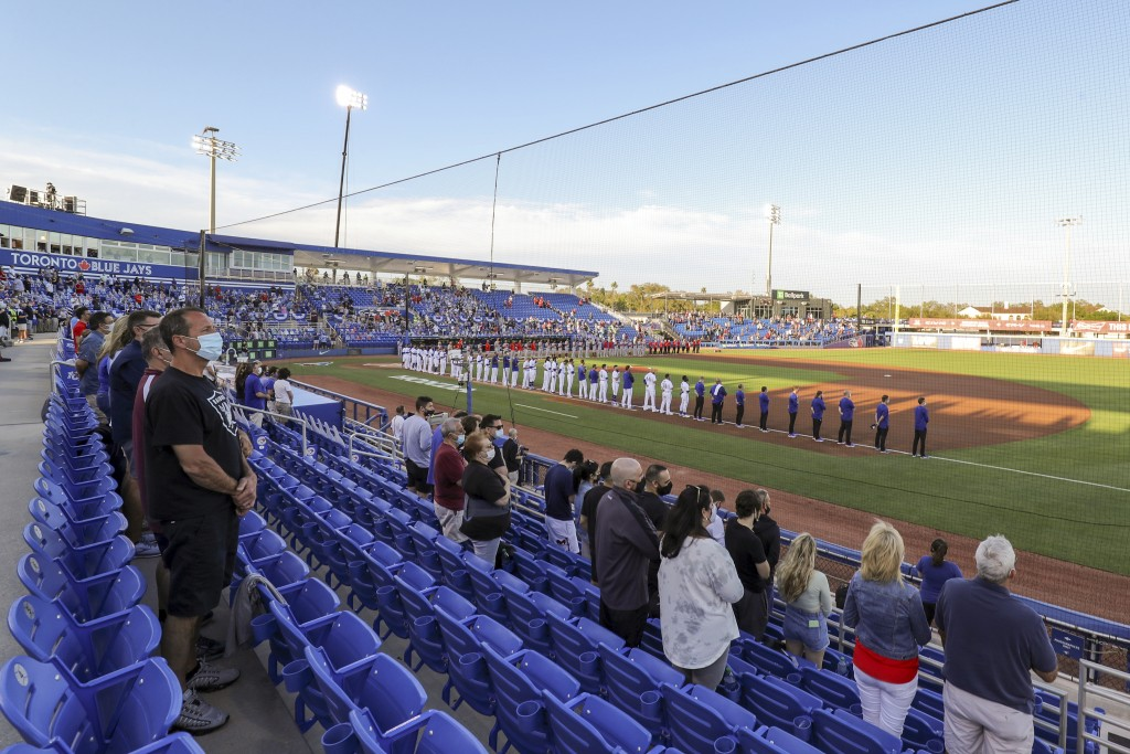 The Los Angeles Angels and Toronto Blue Jays line up for the anthems prior to a baseball game Thursday, April 8, 2021, in Dunedin, Fla. (AP Photo/Mike...