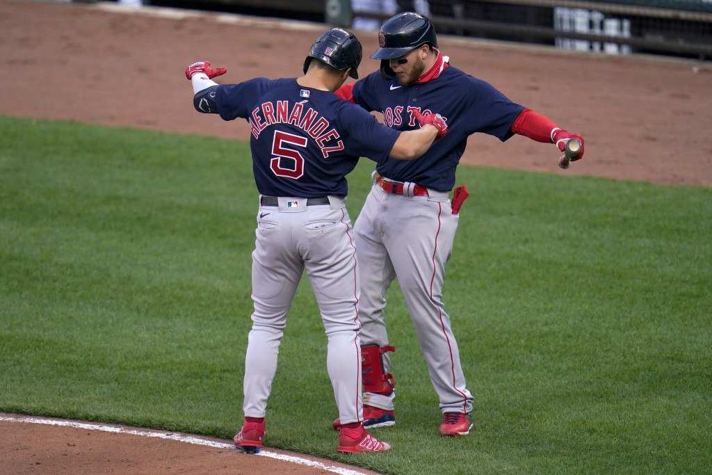 Boston Red Sox's Enrique Hernandez (5) celebrates his solo home run against the Baltimore Orioles with Alex Verdugo during the eighth inning of a base...