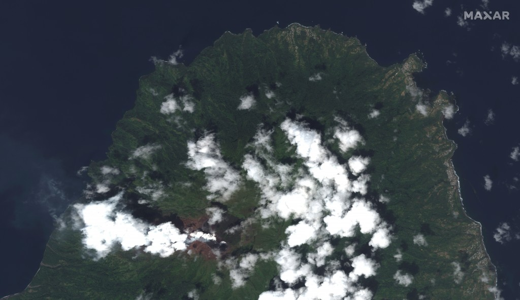 This image provided by Maxar Technologies shows La Soufriere volcano on the Caribbean island of St. Vincent, Thursday, April 8, 2021, the day before i...