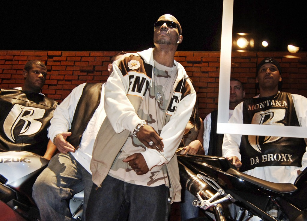 FILE - DMX, whose real name is Earl Simmons, performs following the announcement of his record label change to Sony Music in New York on Jan. 13, 2006...