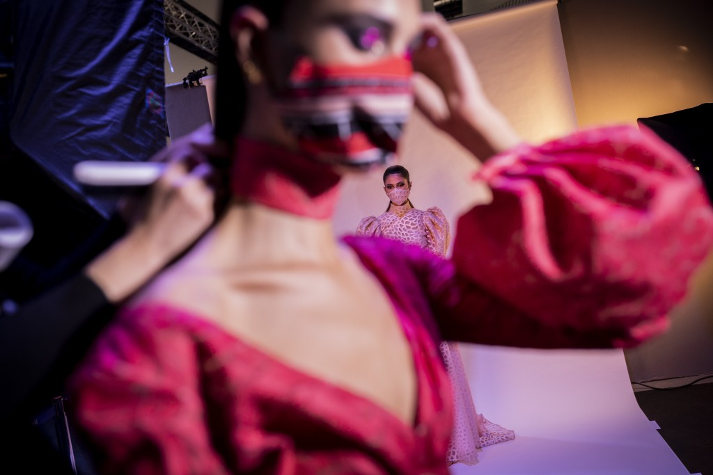 Models wearing Autumn/Winter creations by designer Hannibal Laguna wait backstage during the Mercedes-Benz Fashion Week in Madrid, Spain, Friday, Apri...