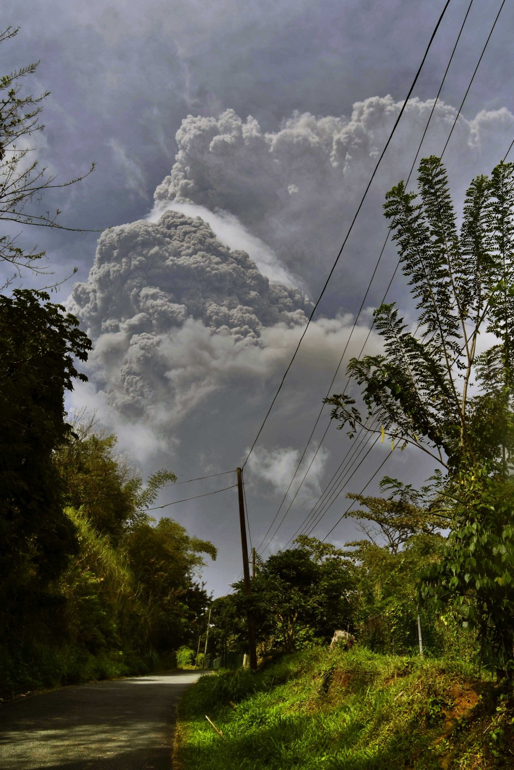 Plumes of ash rise from the La Soufriere volcano as it erupts on the eastern Caribbean island of St. Vincent, as seen from Chateaubelair, Friday, Apri...