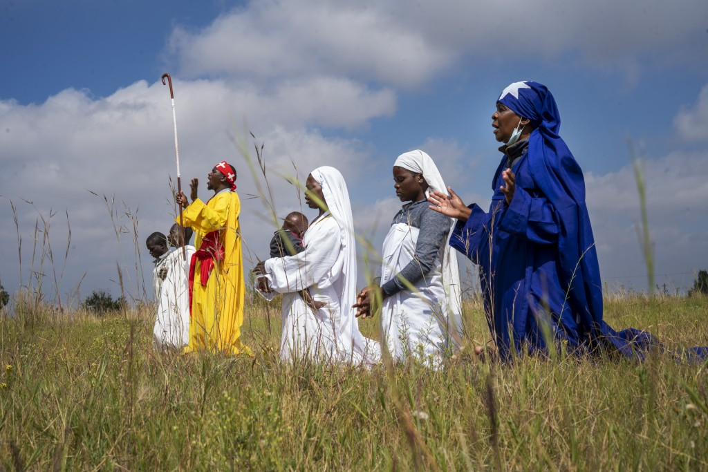 Apostolic Pentecostals celebrate Easter in field in the Johannesburg township of Soweto Sunday April 4, 2021. Similar independent churches in South Af...