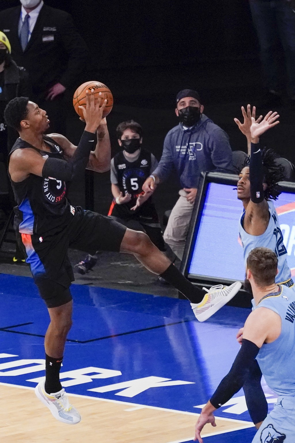 New York Knicks guard RJ Barrett (9) goes to the basket against Memphis Grizzlies guard Ja Morant to tie an NBA basketball game in the final seconds o...