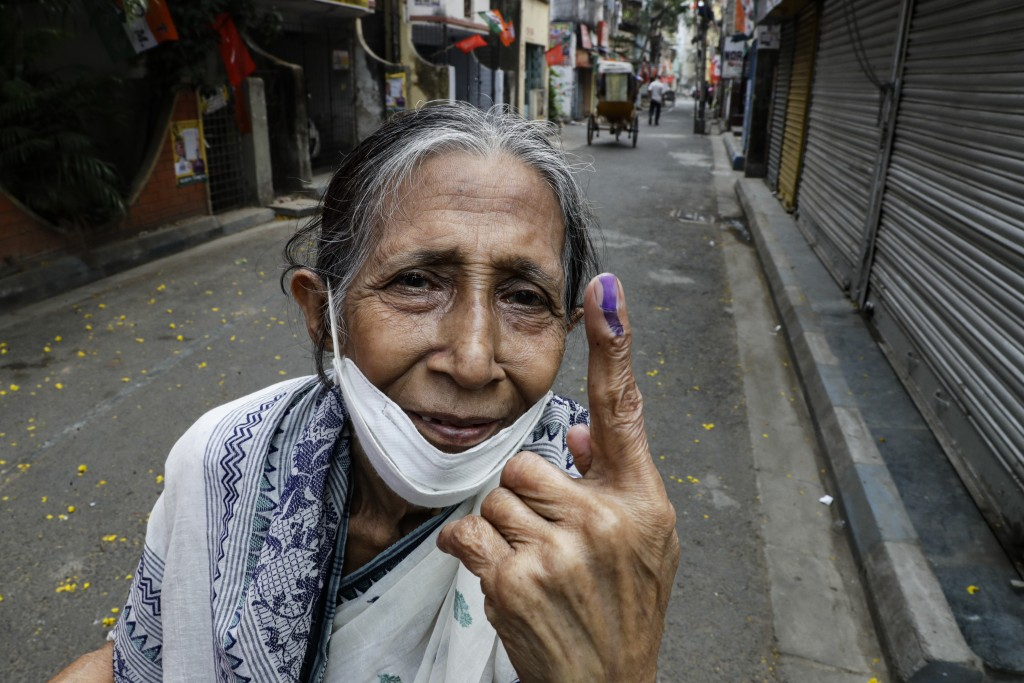 Bani Dasgupta, 75, displays the indelible ink mark after casting the vote during the fourth phase of West Bengal state elections in Kolkata, India, Sa...