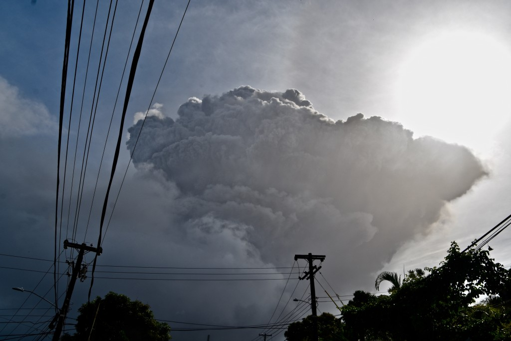 Ash rises into the air as La Soufriere volcano erupts on the eastern Caribbean island of St. Vincent, seen from Chateaubelair, Friday, April 9, 2021. ...