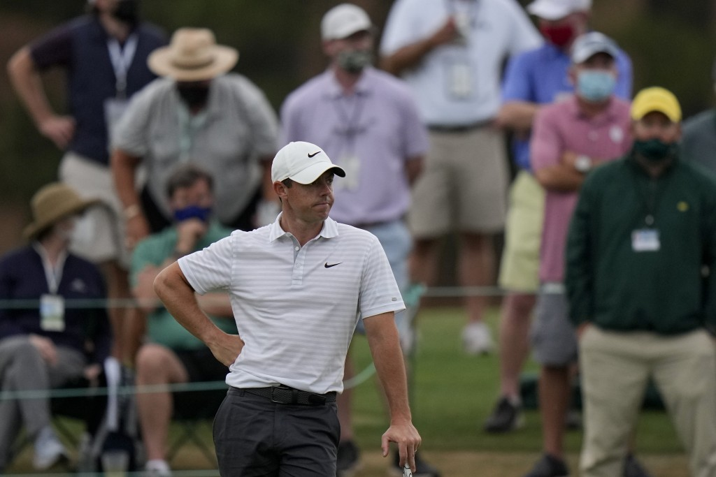 Rory McIlroy, of Northern Ireland waits to putt on the 18th green during the second round of the Masters golf tournament on Friday, April 9, 2021, in ...