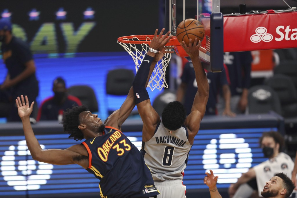 Washington Wizards forward Rui Hachimura, right, shoots against Golden State Warriors center James Wiseman during the first half of an NBA basketball ...